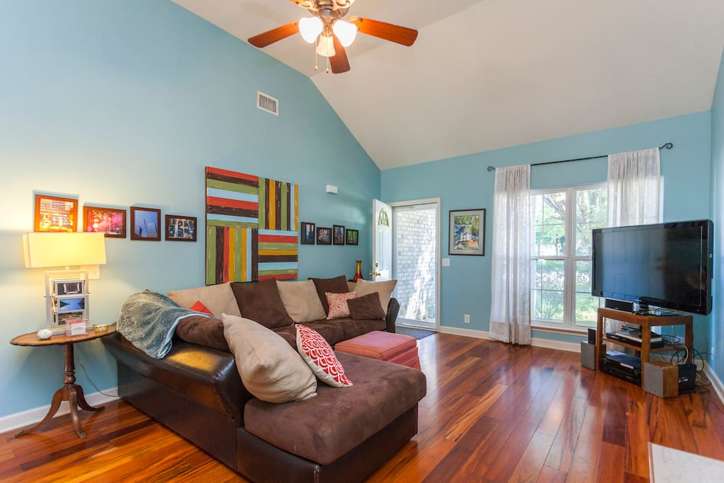 Main entrance to the house - living room with huge cozy sectional and TV that is set up with Hulu, Netflix, and HBO.  The colors are not quite this saturated!