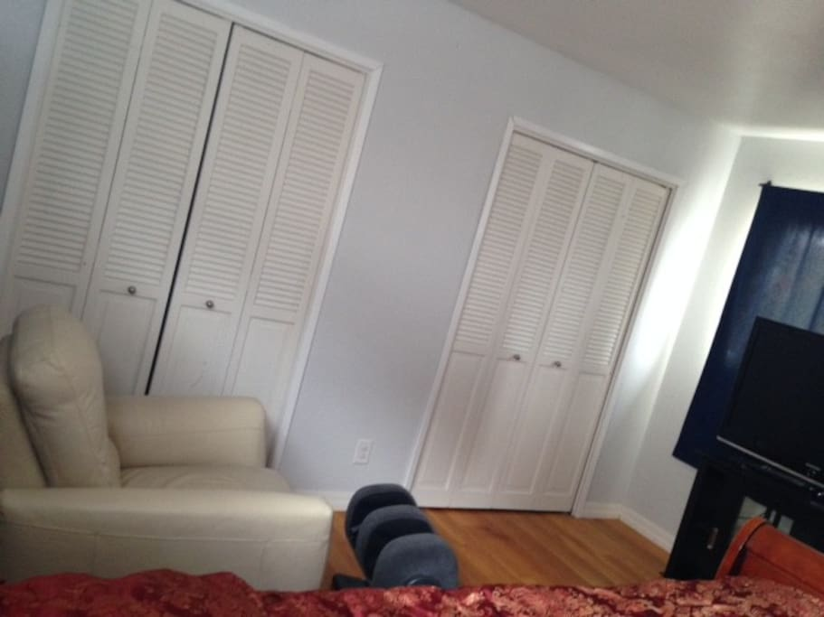 Comfortable lazy boy with flat screen. 3 closets .