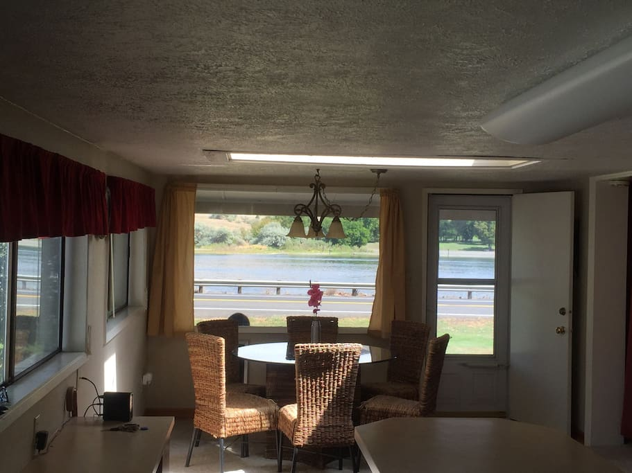 Dining Room with River View. The Front deck is past the front door.