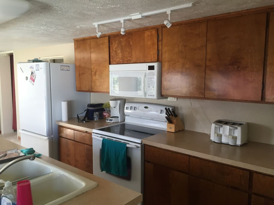 Kitchen with dishwasher, fridge/freezer, electric stove, and microwave