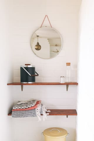 Shelving in the Cement Tent (a detached bedroom)