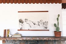 A painting by Rich Combs of the Joshua Tree National Park hangs above the mantle