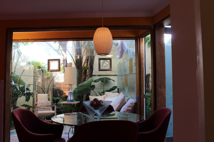 Dining area looking into glass sitting room