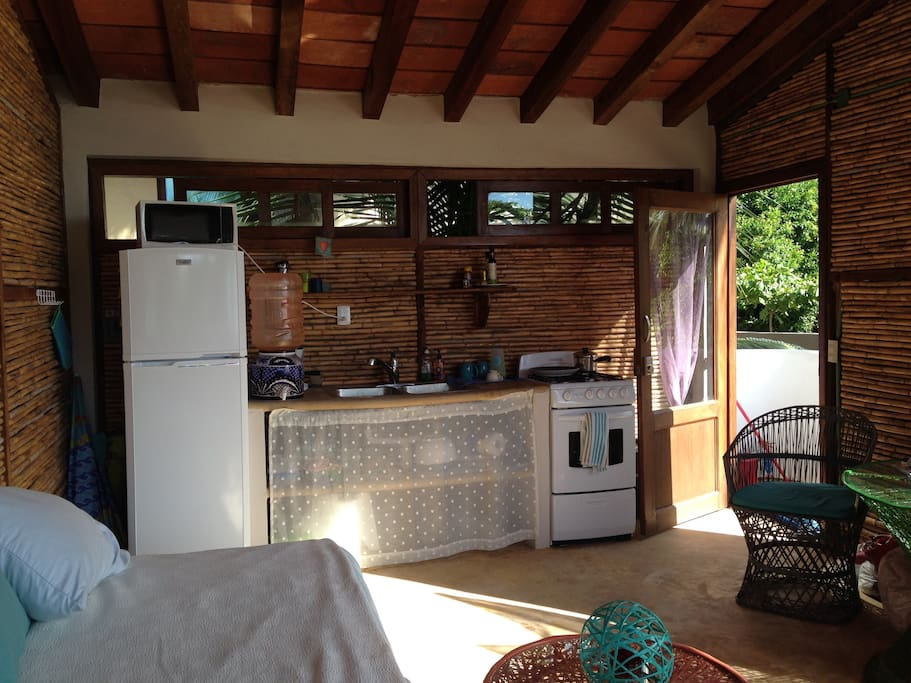 kitchen has 4 gas burner stove, microwave, fridge & freezer