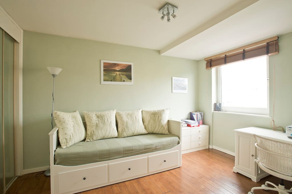 Single/double bed room. This IKEA convertible bed has a wooden slatted base and can be opened as a double bed. This room is always available!