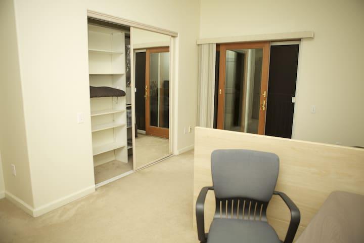 Large closet with mirror doors.