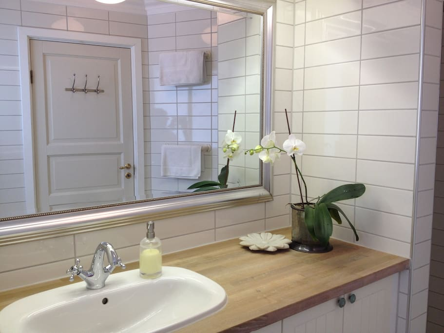 The newly renovated bathroom is shared with the neighbouring room.