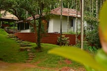 the main cottage surrounded by plantation