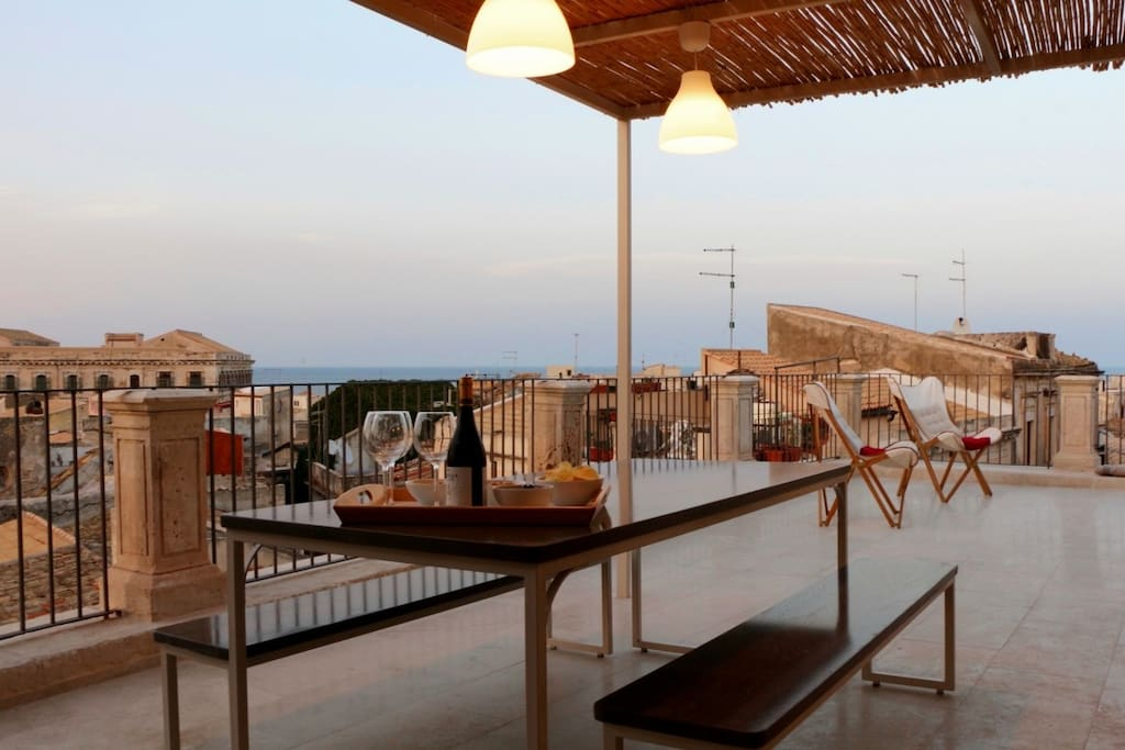The terrace at the sunset at the last level upon the roofs of Ortigia: Apollo suite
