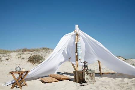 Sleeping on private beach - F&B INC - Stan