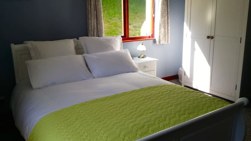 Blue Room is downstairs, dual aspect, with en-suit shower room, Superfast Broadband and smart TV.