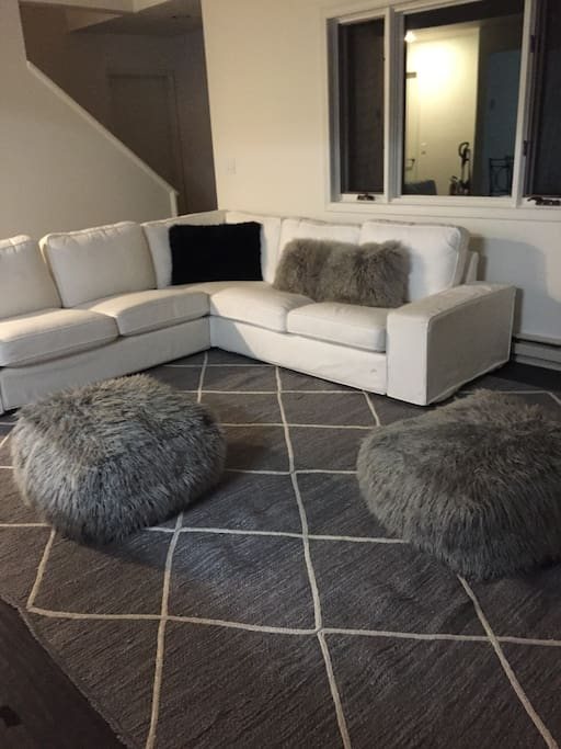 Cozy couch and comfy poufs for relaxing