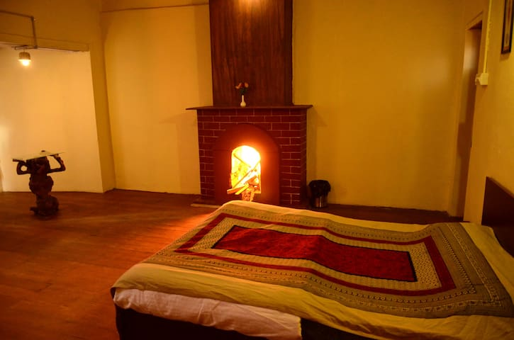 spacious room with a fireplace