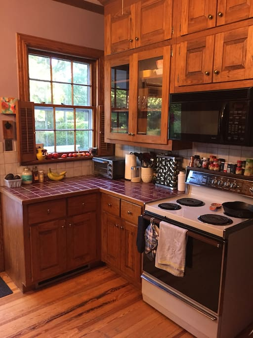 Kitchen w/stove, microwave, toaster oven
