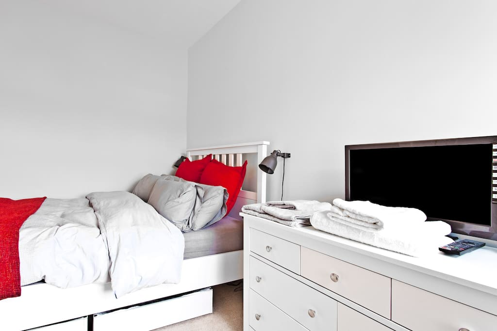 Double bed with private TV and drawers