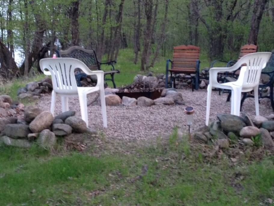 Fire pit relaxation area, next to lake.