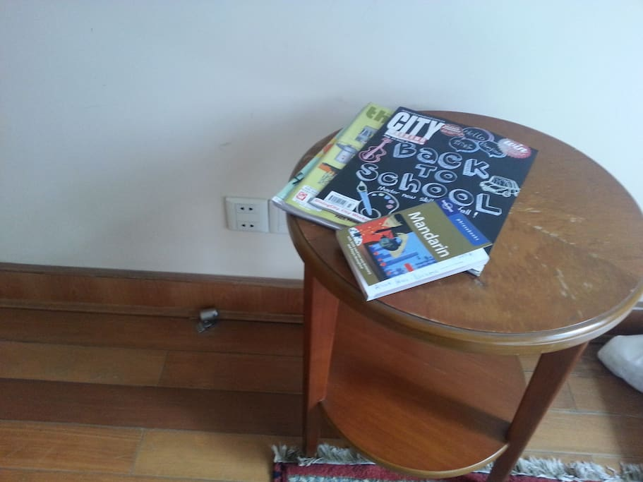 You can pick up city guide, event magazine and simple Mandarin pocket book