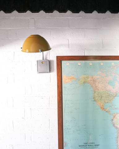 A vintage map hangs in the hallway so you can dream up your next adventure