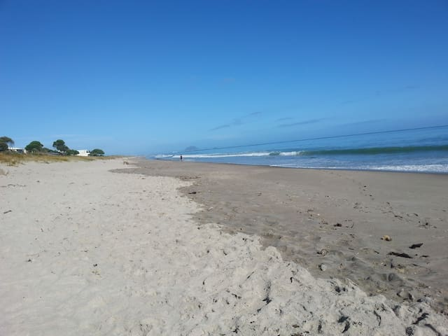 One of NZ most beautiful beaches just across the road.