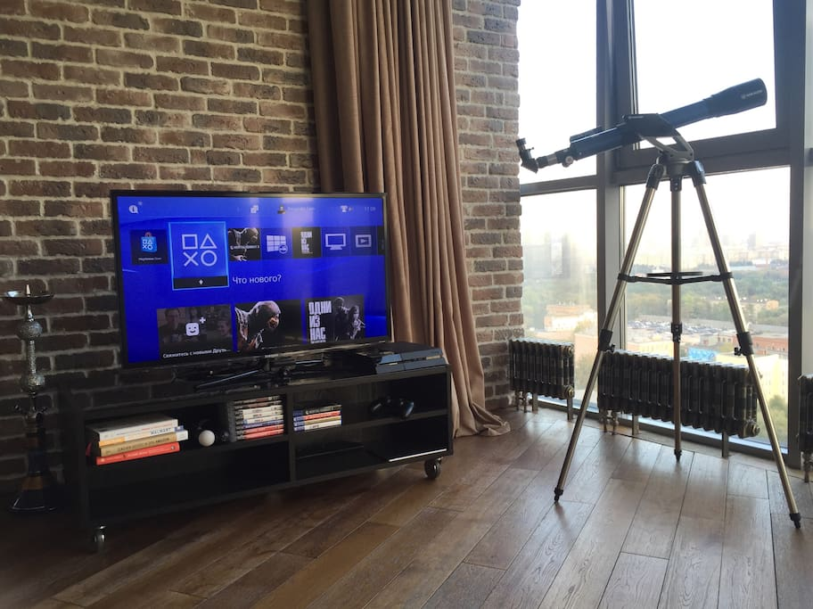 Television, shisha pipe, PS4, telescope, Spotify and iPad Air to control music throughout the apartment