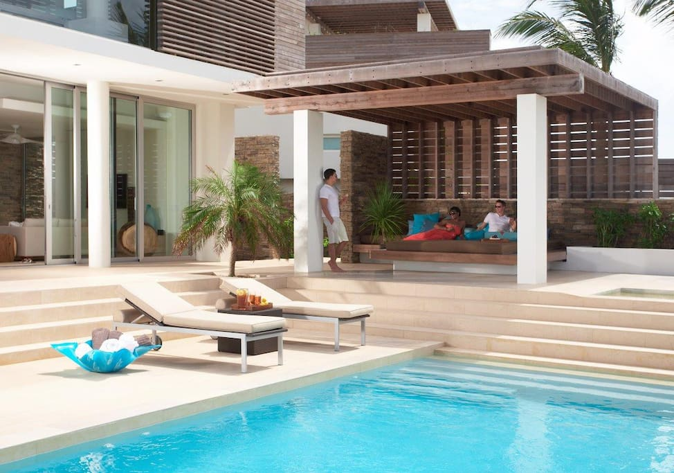 Outdoor lounge area by the pool.