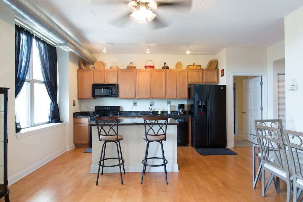 Bright and sunny kitchen/dining area. Fully stocked kitchen with all the amenities.