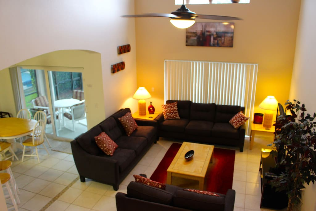 Family living room, large and airy with high ceilings to help keep you cool and huge TV to keep you entertained!
