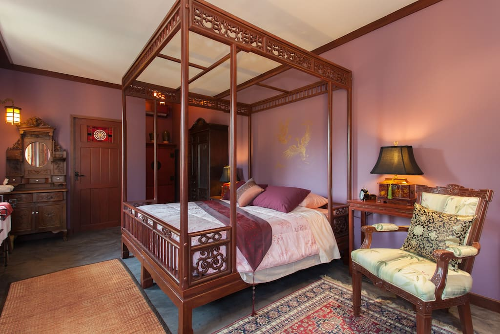 Carved red wood four-poster bed