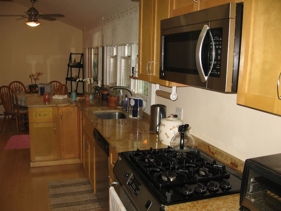Stainless steel appliances and granite countertops.