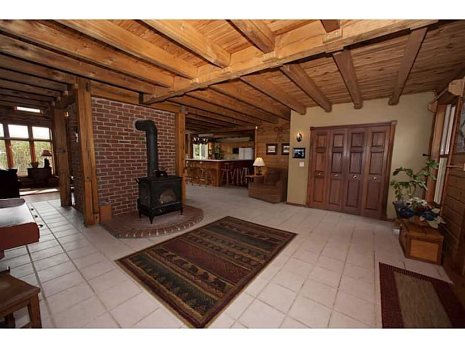Entry area complete with wood stove surrounds us with toasty warmth in the winter.