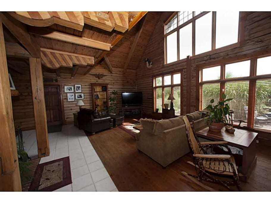 Expansive great room with wood burning fireplace