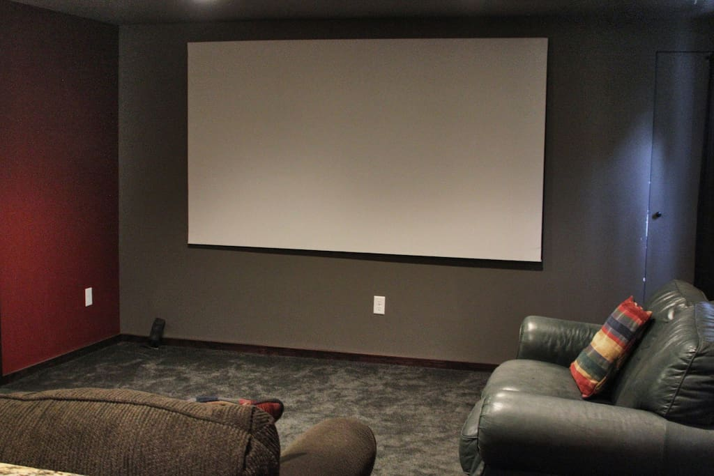 """90"""" theater screen with beautiful 1080p HD projector hooked up to a Roku with Netflix, etc."""