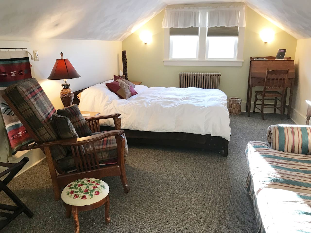 The Nook has slanted ceilings / cozy feel. Most comment how comfortable the room and queen bed  is.  Linens, blanket and warm down alternative quilt in colder months.  Additional pillows and blanket in the closet. A/C in warmer months.