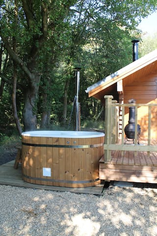Step into the wood-burning hot tub straight from the decking!