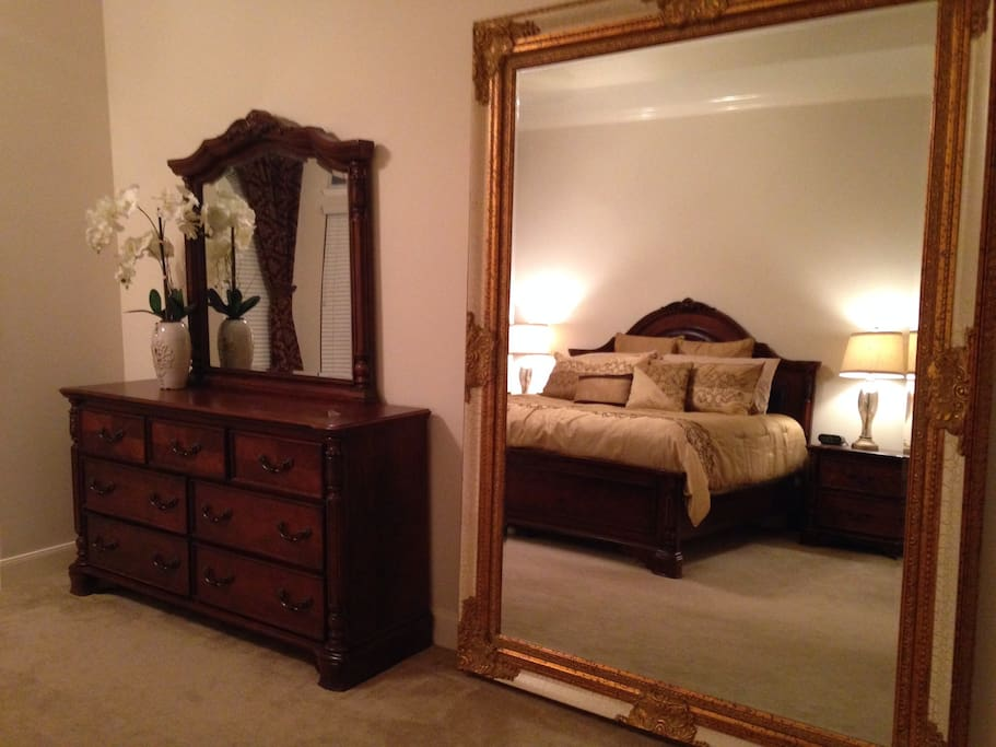 Elegant 7-drawer dresser for you to organize and palace size mirror reflects your best!