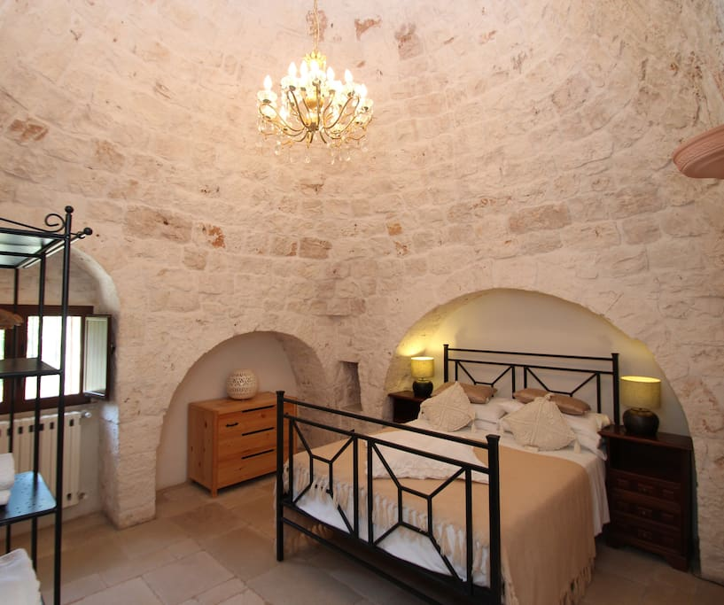 Bedroom with King Size bed (5ft) in a cone of Trullo.