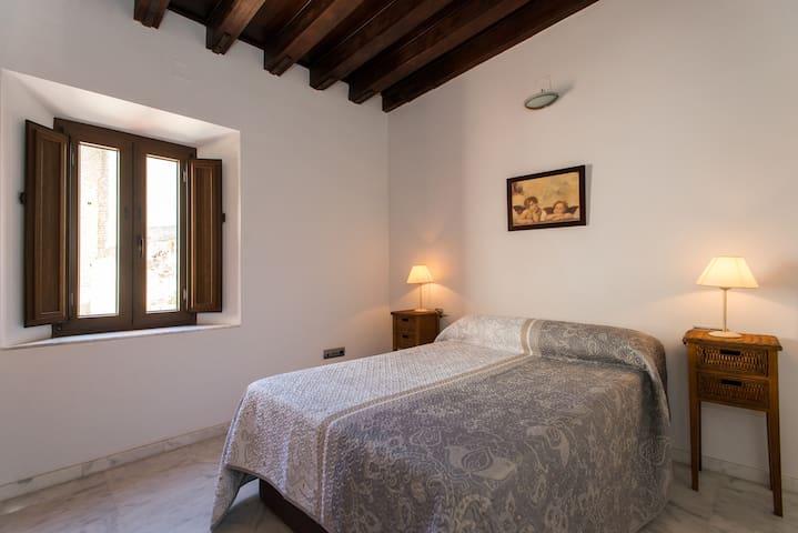 Cozy bedroom with original wooden ceiling