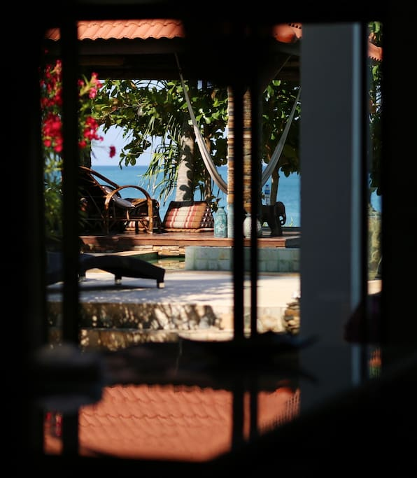 From kitchen, looking out over the pool and sala