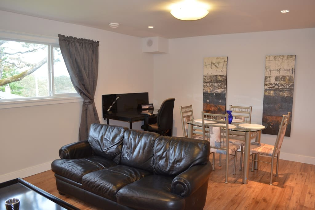 Dining area, office desk, large window from elevated, above grade lower level lets in lots of light, with great views