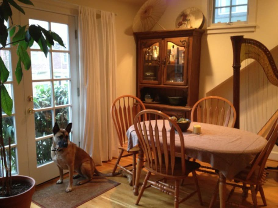 Dining area and front balcony (and the house dog)