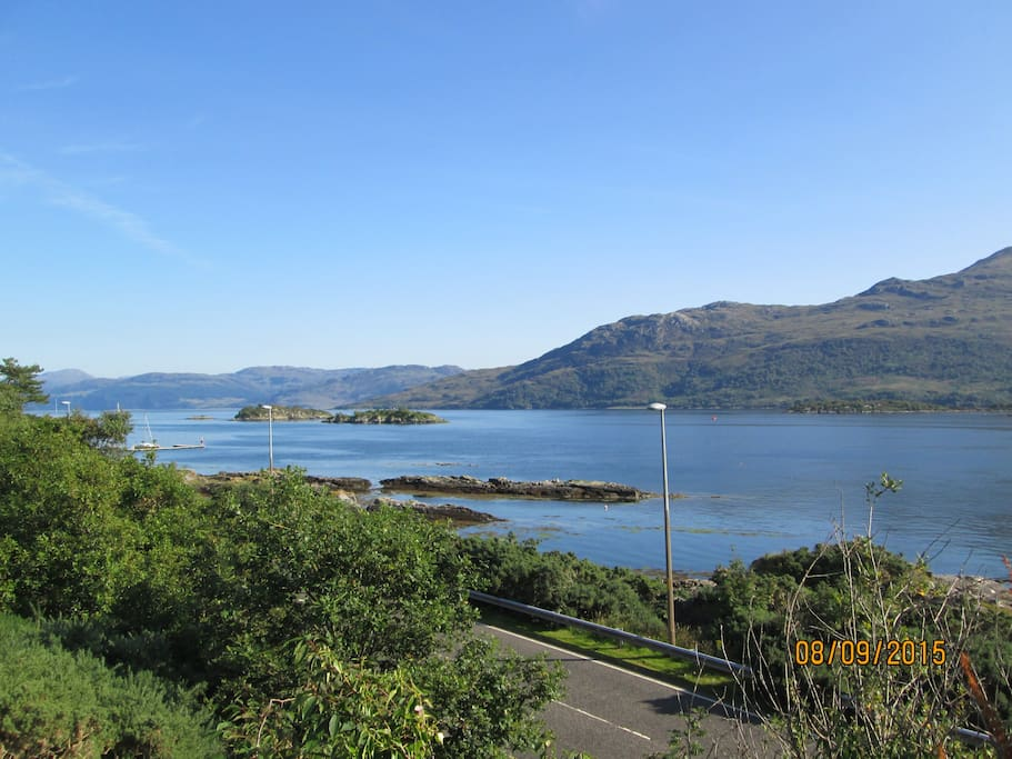 This is the view over the water to Skye, seen from the top of the steps down to the cottage. You can see the Skye Bridge Road also and unfortunately hear the traffic.