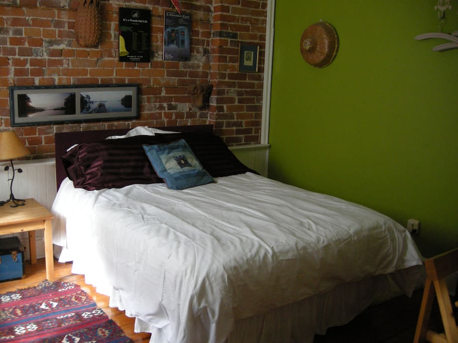 The Green Room has a comfy double bed, desk, and dresser.