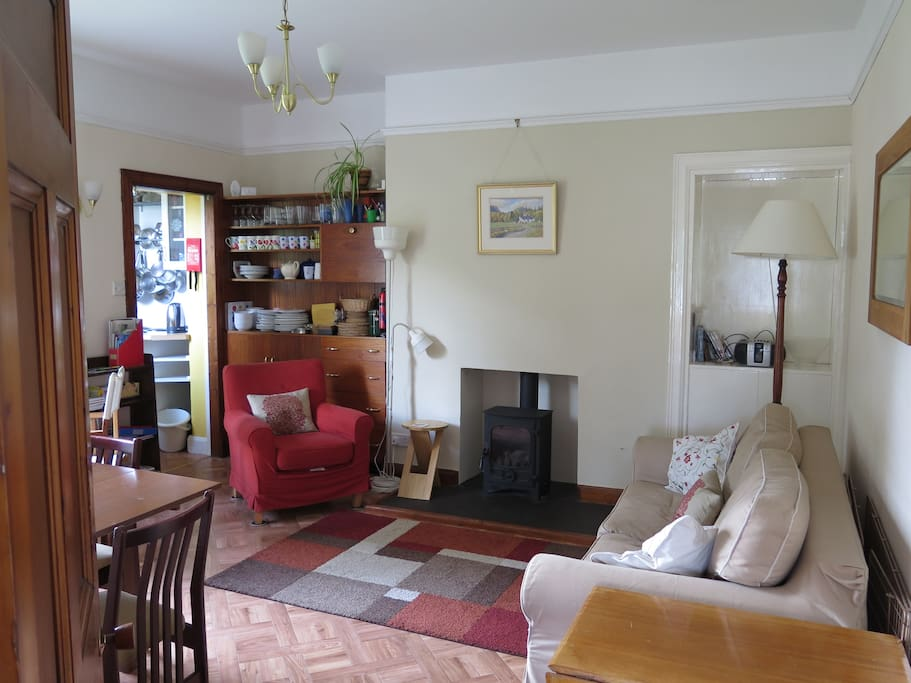 Sitting room with gas fire and kitchen