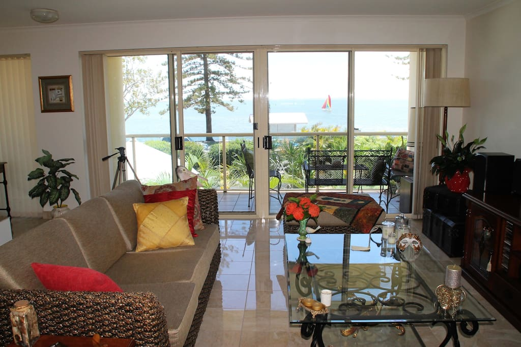 Relaxed lounge room with Moreton Bay and Esplanade views