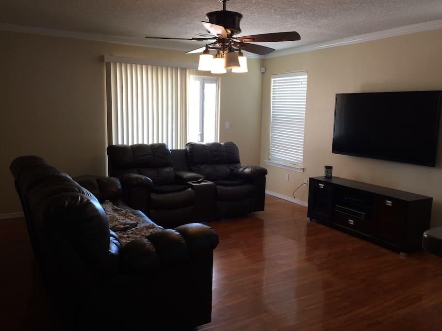 Comfy spacious living room and big screen TV