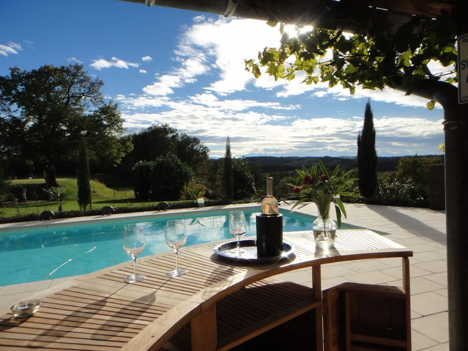 Enjoy a glass of wine or cocktail by the pool.
