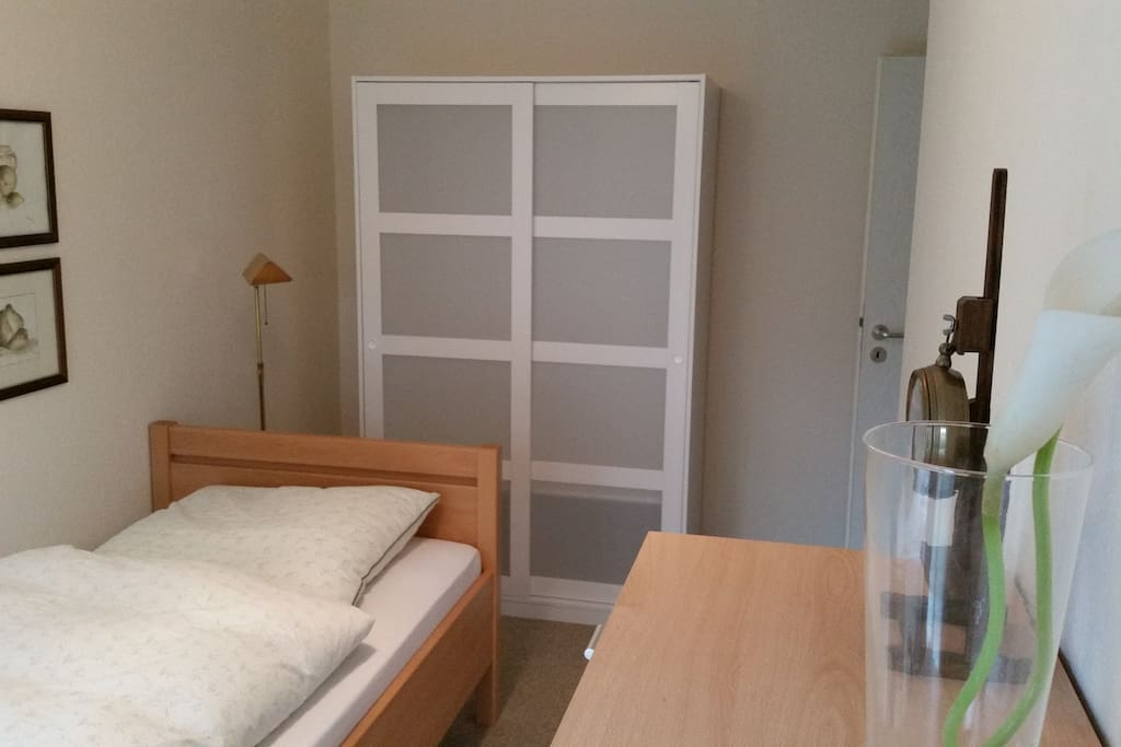 A spacious wardrobe is part of the room as well.
