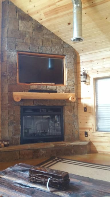 Fireplace and 64 inch TV