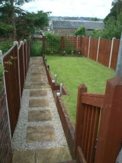 Back garden area has decking and a little fenced off are with chickens at the bottom supplying fresh eggs each day.