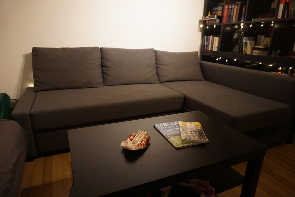 The couch will convert and give a comfy place to spend the night.